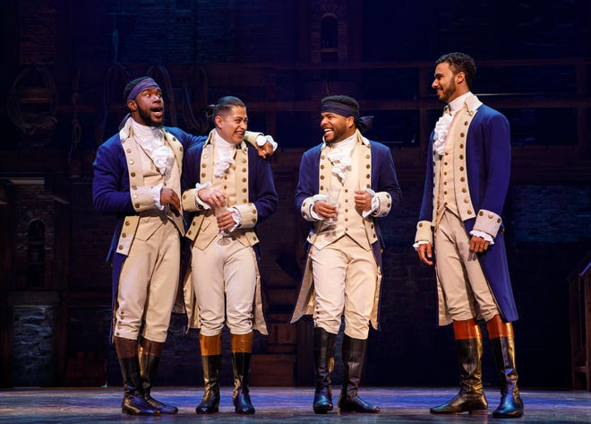 """Chaundre Hall Broomfield (far left), Ruben J. Carbajaland (left), Bryson Bruce (right) and Andrew Scott (far right) perform in the national tour of """"Hamilton."""" The Broadway hit is returning to ASU Gammage in 2021."""