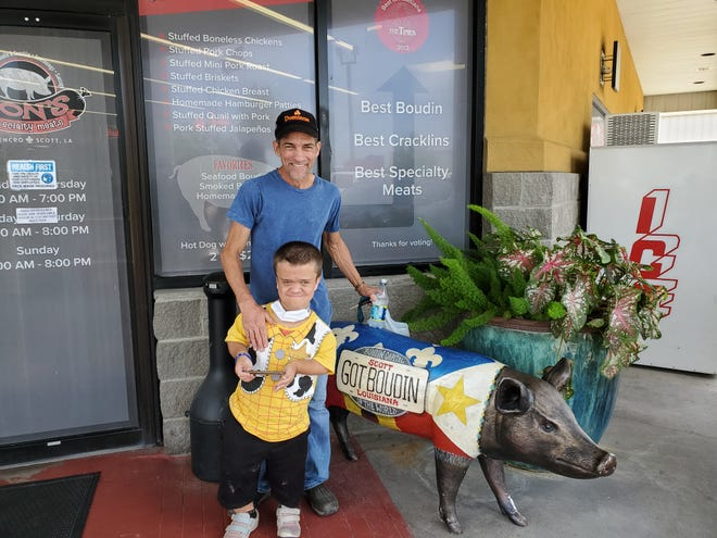 Jockey Gerard Melancon, in blue, poses with Dylan Kerkhoff outside a restaurant in this undated photograph. The two developed a friendly relationship after Melancon gave Kerkhoff a trophy after a race.