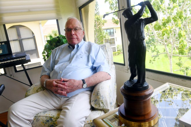 Jay Edwards, 92, a retired dentist now living in Vero Beach, sits next to the Golf Writers Association of America's Ben Hogan Award he accepted on behalf of his son Bruce Edwards, the longtime caddy for professional golfer Tom Watson. Bruce Edwards was honored with the award in 2004 while remaining active in the sport while suffering from amyotrophic lateral sclerosis, or ALS. Jay Edwards accepted the award for his son in April 2004 in Augusta, Georgia on the eve of the Masters tournament. By the following morning, Bruce Edwards had succumbed to his illness at the age of 49.