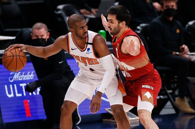 Phoenix Suns guard Chris Paul (3) controls the ball against Denver Nuggets guard Facundo Campazzo,