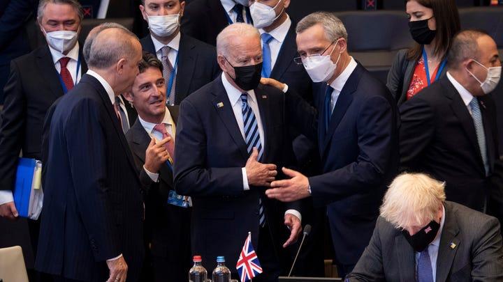 Turkey's President Recep Tayyip Erdogan, left, and NATO Secretary General Jens Stoltenberg, center right, speak with U.S. President Joe Biden, center, during a plenary session during at NATO headquarters in Brussels, on June 14, 2021.