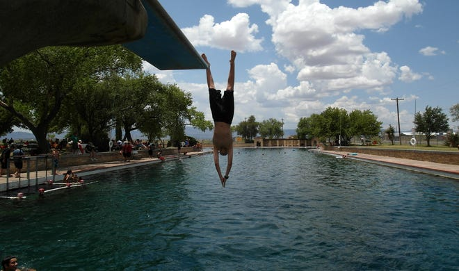 The swimming pool diving board is a popular draw at Balmorhea State Park in west Texas. Jay Godwin/American-Statesman 7/8/12