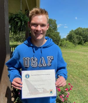 Lake Mills poses with his Certificate of Appointment from the U.S. Air Force. Mills will report to the U.S. Air Force Academy in Colorado Springs, Colorado, on June 24.