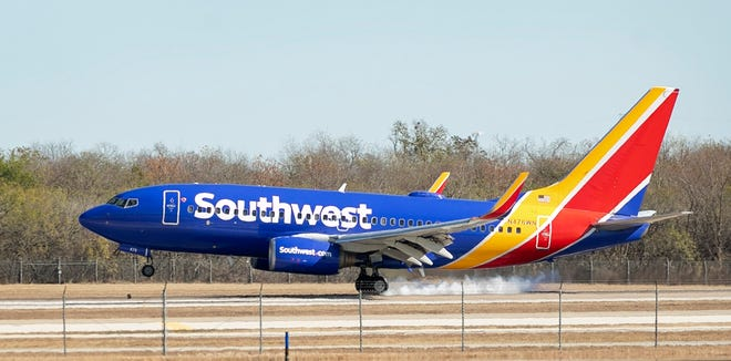 A Southwest Airlines jet lands at Austin-Bergstrom International Airport on Dec.7, 2020. Southwest grounded flights across the country Tuesday amid reports of a nationwide computer issues. Some flights at Austin-Bergstrom International Airport were affected, but as of Tuesday afternoon, operations were back to normal, an ABIA spokesman said