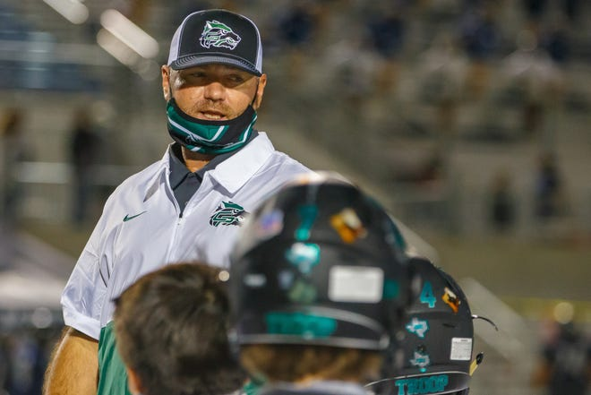 Cedar Park coach Carl Abseck, speaking to his team after a victory over Hendrickson in October, will leave the Timberwolves to become head coach and athletic director at Barbers Hill.