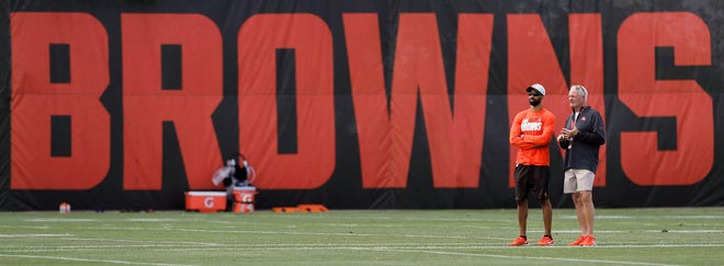 Cleveland Browns General Manager Andrew Berry, left, and owner Jimmy Haslam observe from the sideline during an NFL football practice at the team's training facility, Tuesday, June 15, 2021, in Berea, Ohio.