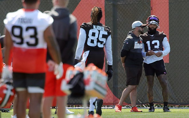 Cleveland Browns wide receiver Odell Beckham Jr. (13) watches from the sideline during an NFL football practice at the team's training facility, Tuesday, June 15, 2021, in Berea, Ohio.