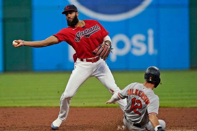 Cleveland's Amed Rosario, left, gets Baltimore Orioles' Stevie Wilkerson at second base in the third inning of a baseball game, Monday, June 14, 2021, in Cleveland. Rosario was able to make the throw to get Orioles' Cedric Mullins at first base for a double play. (AP Photo/Tony Dejak)