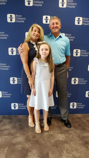 James and Marguerite Pearson, shown with theier granddaughter Elise Bonsky, have established the James F. and Marguerite A. Pearson Endowed Chair in NeuroDevelopmental Sciences for Rare Diseases at Akron Children's Hospital with a $2 million gift.