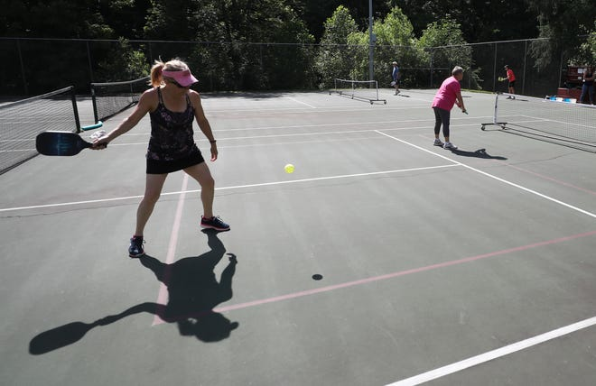 Julie Sanderbeck gets set to hit a return during a game of pickleball at Adell Durbin Park in Stow earlier this summer. The city of Hudson is hoping to build 12 pickleball courts in 2022.