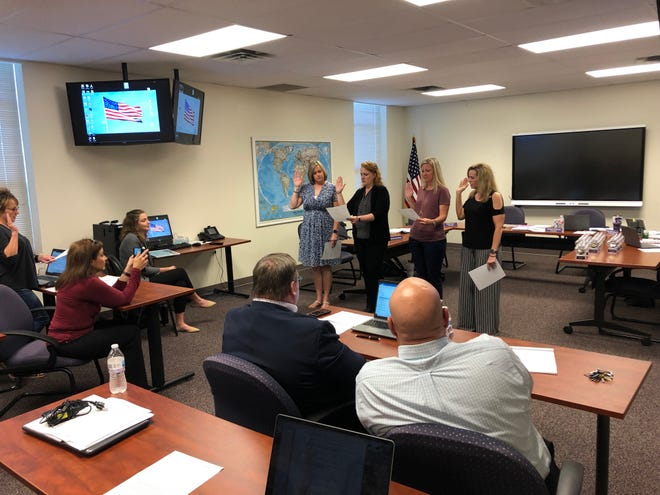 From left: Danielle Coleman, Melinda Powell, Nikki Forrest and Amanda Brown take their respective oaths of office after being elected to the River Road ISD Board of Trustees during Monday's meeting.