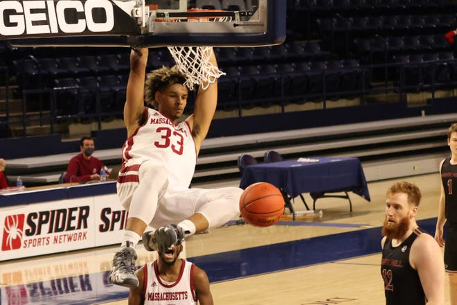 Former UMass forward Tre Mitchell had plenty of dunks with the Minutemen. Now at Texas, Mitchell is expected to hold down the middle with Utah transfer Timmy Allen.