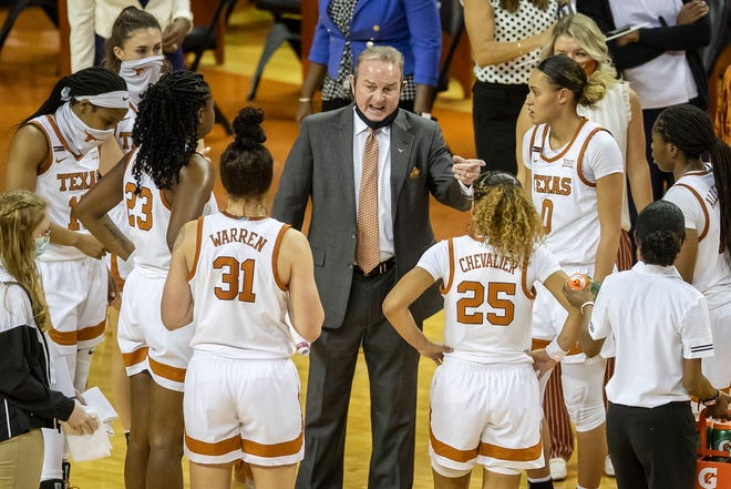 Texas head coach Vic Schaefer instructs his players during a game against Louisiana Tech at the Erwin Center on Dec. 2, 2020 in Austin.