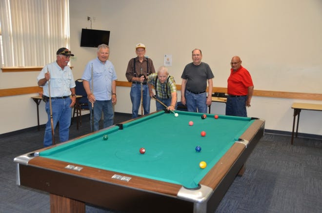 Pictured, left to right are Snooker players who enjoy playing and watching the game, Orville Hartline, Bob Mutusic, Dan Shank, Ed Bump, Charlie Clark and Denny Thompson. They are some of the best players in the Canton area.