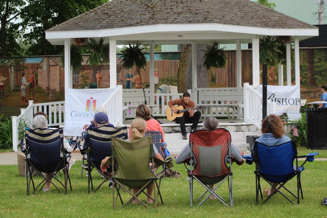 A large group of people gathered in Washington Park Thursday evening for the first concert of the summer. Nathan Towne, a local musician, performed an hour long acoustic concert for those in attendance.