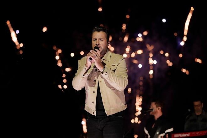 """Luke Bryan performs """"Down to One"""" at the CMT Music Awards on May 12, 2021, in Nashville, Tenn. The awards show airs on June 9 with both live and prerecorded segments. (AP Photo/Mark Humphrey)"""