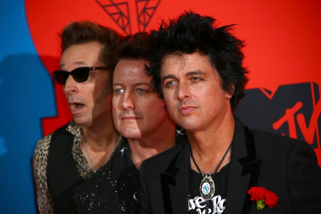 Singer Billie Joe Armstrong, from left, Tre Cool and Mike Dirnt of the band Green Day pose for photographers upon arrival at the European MTV Awards in Seville, Spain, on Nov. 3, 2019.