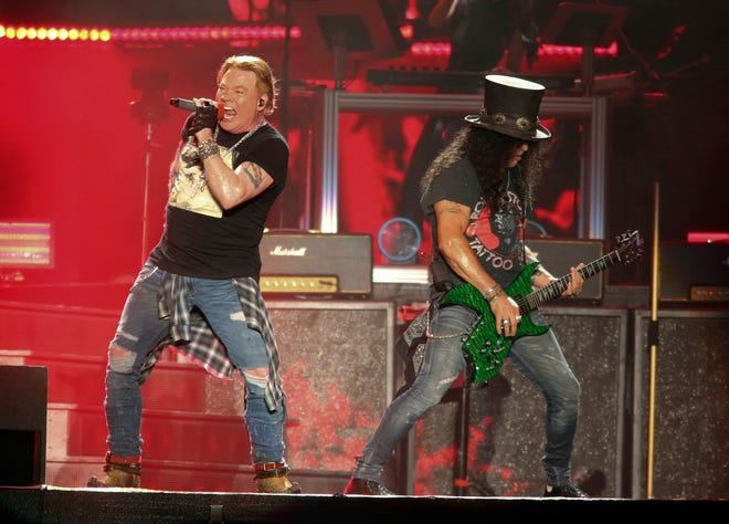 Guns N' Roses' Axl Rose, left, and Slash perform on the first weekend of the Austin City Limits Music Festival on Oct. 4, 2019, in Austin, Texas.