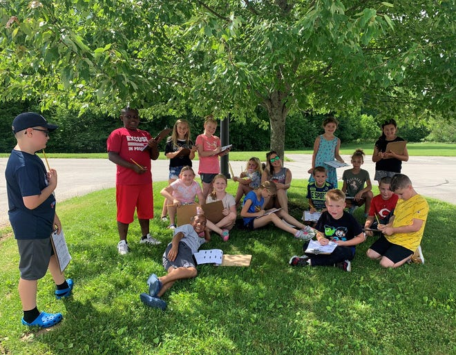 Cambridge City Schools students participating in the Summer CATS Camp completed a nature scavenger hunt as part of the interactive, hands-on learning experience.