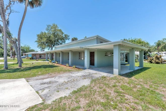 This expansive concrete-block home is nestled high and dry on a corner lot in the laid-back community of Harbor Oaks in Port Orange.
