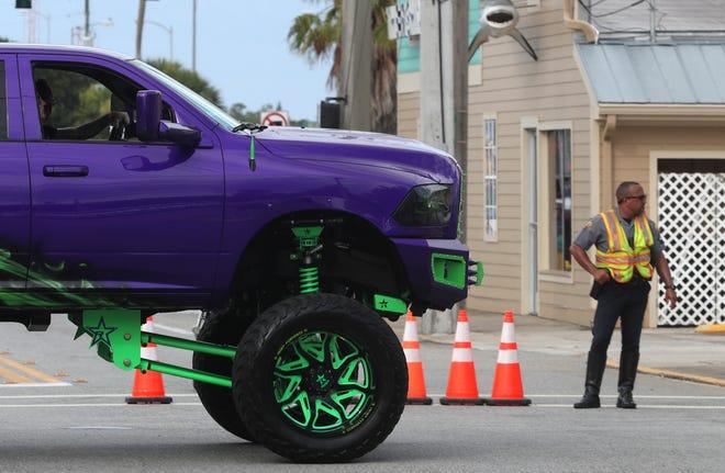 A Daytona Beach police officer works traffic on the Main Street Bridge in Daytona Beach on Saturday,  June 12, 2021.