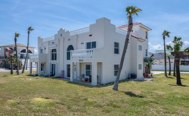 Experience the most stunning direct oceanfront views from this gorgeous Mediterranean-style, three-story townhome in peaceful Ormond-by-the-Sea.