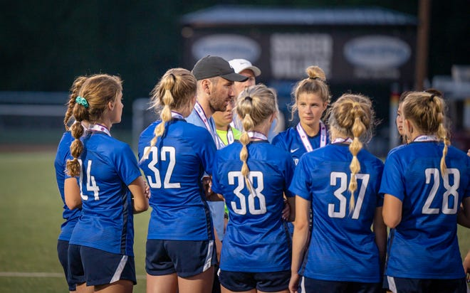 Grain Valley coach Tyler Nichol, center, speaks with his team following its 5-2 loss to Fort Zumwalt South in the Class 3 state championship game. Nichol is stepping down as the Eagles' head coach to pursue an opportunity in private business.