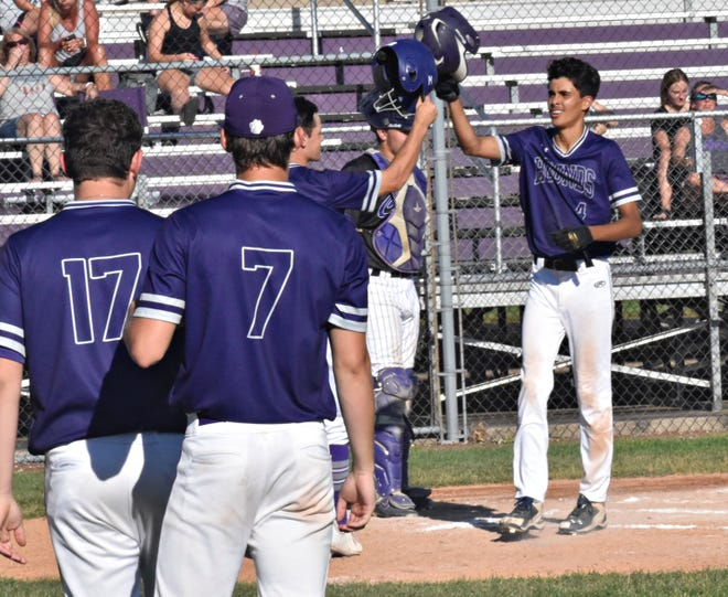Burlington High School's Juan Reyes (4, at right) accepts congratulations from his teammates after he hit a two-run home run in the second inning of Monday's first game against Keokuk at Wayne Duke Field.