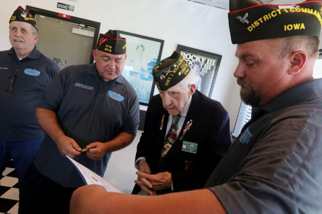1st District Commander for the Iowa Veterans of Foreign Wars Gary Ruffcorn, right, reads the contents of the Continuous Membership Award being presented Tuesday to World War II Army veteran Milton Branchini for his 75-year membership in the VFW during a ceremony at the Made-Rite restaurant in West Burlington.
