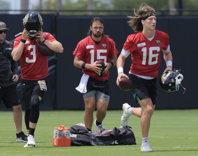Jaguars quarterbacks C.J. Beathard (3), Gardner Minshew II (15)  and Trevor Lawrence (16)  race to a drill during Monday's mini-camp practice. All three had a good day in the final practice before training camp begins in late July. [Bob Self/Florida Times-Union]