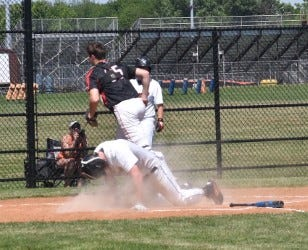 Orion catcher Chance Stropes runs to retrieve the ball before the runner arrives from third during the bottom of the first inning of the regional semifinal game with Macomb on the Bomber diamond on Friday morning, June 4. The runner scored after tagging up when the batter lined out to right fielder Quinn Hoftender