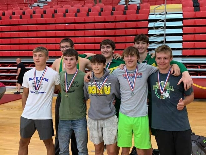 Wrestlers who qualified for Regional competition included, in front from left, Anthony Montez, Logan Tuggle, Carson Raya, Bruce Moore, Harrison Neumann; in back, Levi Neumann, Tim Stohl and Clay DeBaillie. Jack Snyder and Bennett Kreiner also qualified for Regional, but are missing from the photo.