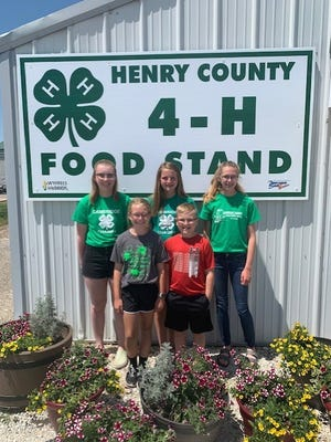 Pictured to welcome you to this year's 4-H Food Stand are Cambridge Champs 4-H members (back left) Baylee Palmer, Miranda Reed, Jolene Blackert, and (front) Livvy and Lawson Edmund