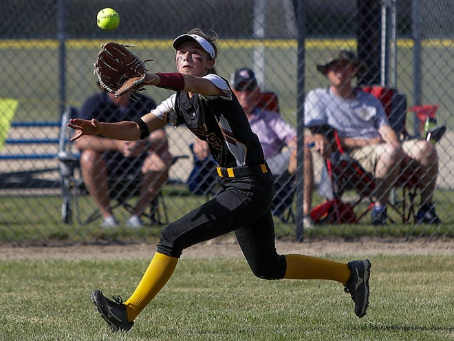 ROWVA-Williamsfield junior left fielder Olivia Farquer tracks down a fly ball for an out during the Cougars' 11-4 loss to Orangeville in the Class 1A Supersectional in Sterling on Monday, June 14, 2021.