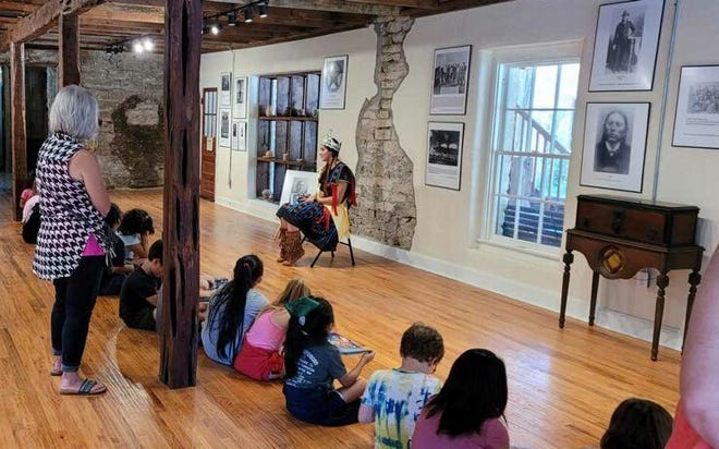 Youngsters listen on Tuesday to Savanah Castillo, a Glen Rose High School student and Apache princess, present a talk on Quanah Parker and the One Man, Two Worlds Exhibit at Barnard's Mill & Art Museum. Somervell County, Barnard's Mill, Glen Rose ISD and Radiant Swim School hosted Cool Reads, a program offering local students the ability to receive free books in order to encourage summer reading. The next event is coming on Thursday, June 24, at Heritage Park on kayaking and water safety.