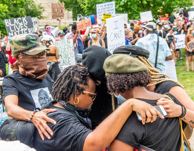 Rich Janzaruk won first place in the SPJ multiple group picture category for his work photographing a rally against racial injustice in 2020.