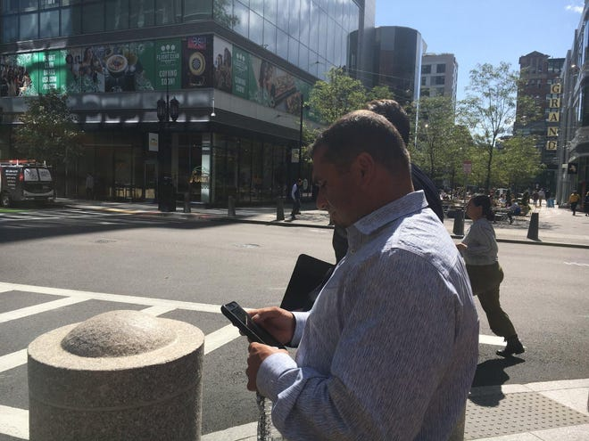 In this photo from 2019, Tony Costa leaves federal court in Boston after pleading guilty to extortion charges.
