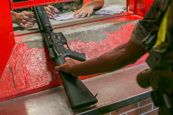 In this June 21, 2019 photo made available by the U.S. Marine Corps, a recruit receives a rifle at Marine Corps Recruit Depot, Parris Island, S.C. The armory is in charge of over 10,000 rifles on Parris Island. In the first public accounting of its kind in decades, an Associated Press investigation has found that at least 1,900 U.S. military firearms were lost or stolen during the 2010s, with some resurfacing in violent crimes. (Lance Cpl. Ryan Hageali/U.S. Marine Corps via AP)