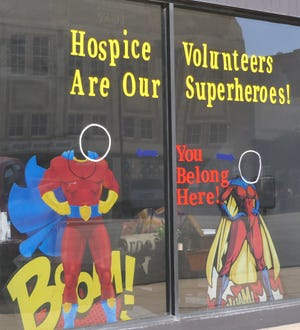 Hospice Care of Kansas carries the theme of Smallville in their window display on Main Street.