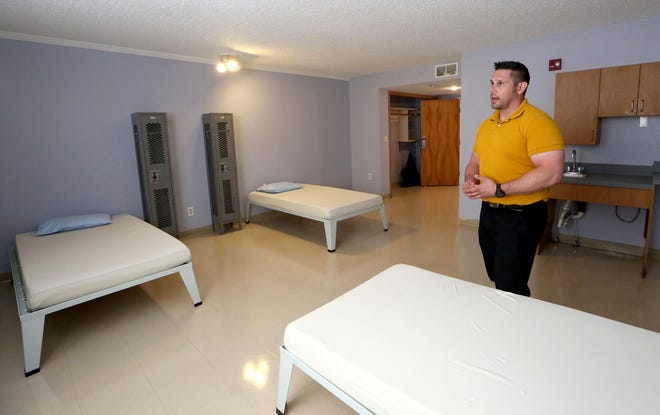 SACK Residential Treatment facility manager Chad Harmon talks about the three beds in a room that will be used for people going through detoxification.