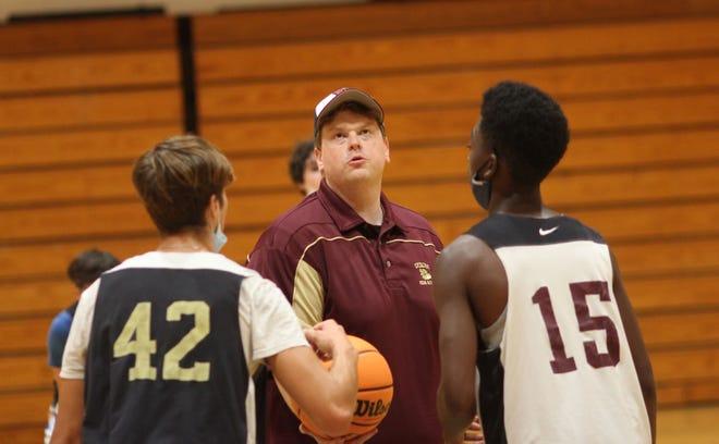 Dixon basketball coach Daniel Casey prepares to toss the ball up during a recent summer workout. [Chris Miller / The Daily News]