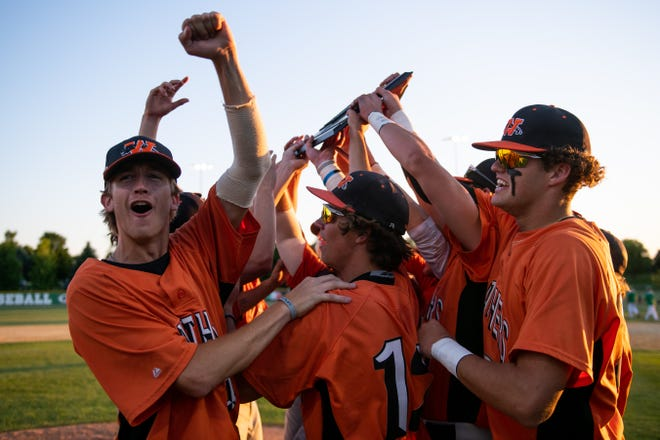 Washington celebrates after winning the Class 3A Geneseo Super Sectional 7-2 over Geneseo at Richmond Hill Park on Monday, June 14, 2021. The win advances Washington to the state tournament later this week.