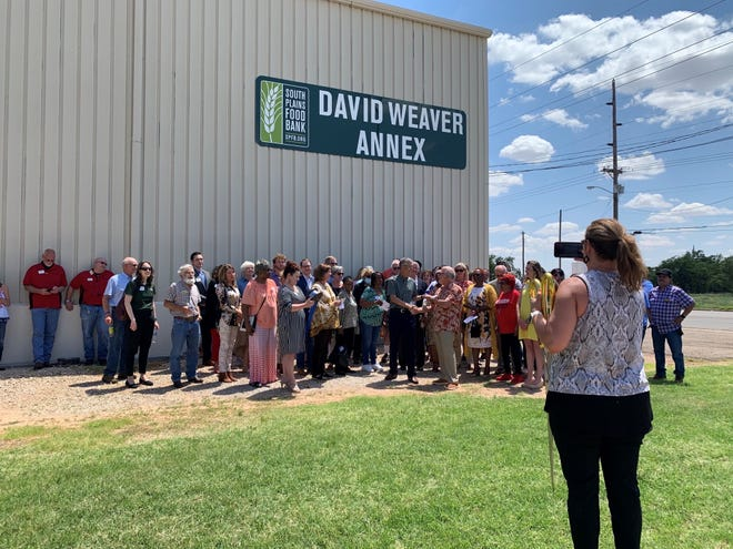 Officials with the South Plains Food Bank and others from the community gathered Tuesday afternoon to unveil the new David Weaver Annex at the food bank.