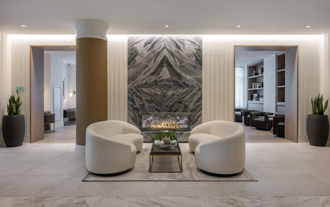The enjoyment begins upon arrival at 100 Shawmut, stepping into the beautifully appointed lobby, punctuated by a stunning pass-through fireplace.