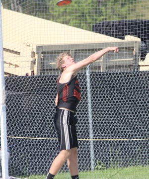 In this McDonough County Voice file photo, Macomb's Adam Farr throws the discus.