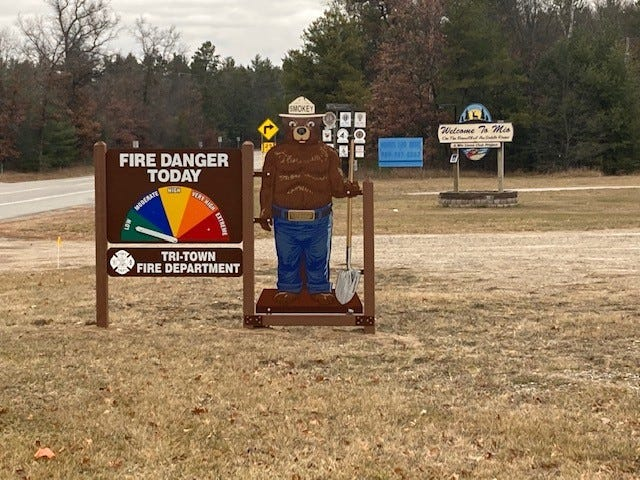 Forest visitors and area residents are greeted by a sign featuring Smokey the Bear that sits on M-72 at the village limit of Mio in Oscoda County pointing to the current fire danger for the area. The new signage is a collaboration between Tri-Town Volunteer Fire Department and the Huron-Manistee National Forests.