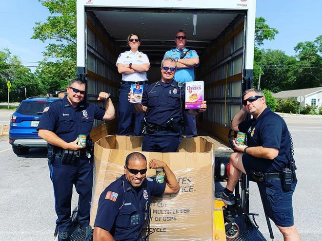 Fire and police department personnel set a new record with 20,233 pounds of healthy food and $21,582 donated during the June 23-25 Donut Strike event for the Manna Food Bank in Pensacola.