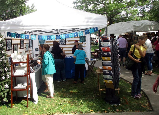 Guests visit with the vendors at the Colorscape Arts Festival in Norwich in this 2019 file photo. The event returns Sept. 11-12 and their Literary Arts Tent is looking for authors, illustrators and poets to join the experience.