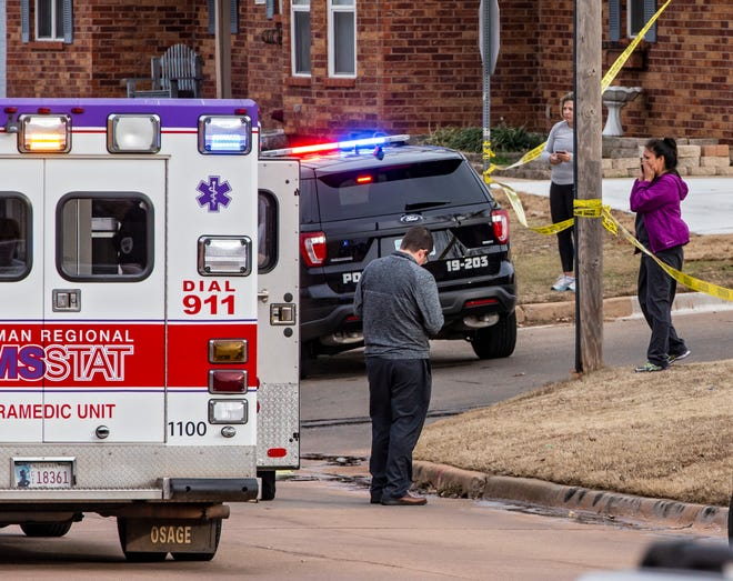 People react as emergency crews respond after a pickup slammed into a group of Moore High School runners on Feb. 3, 2020.