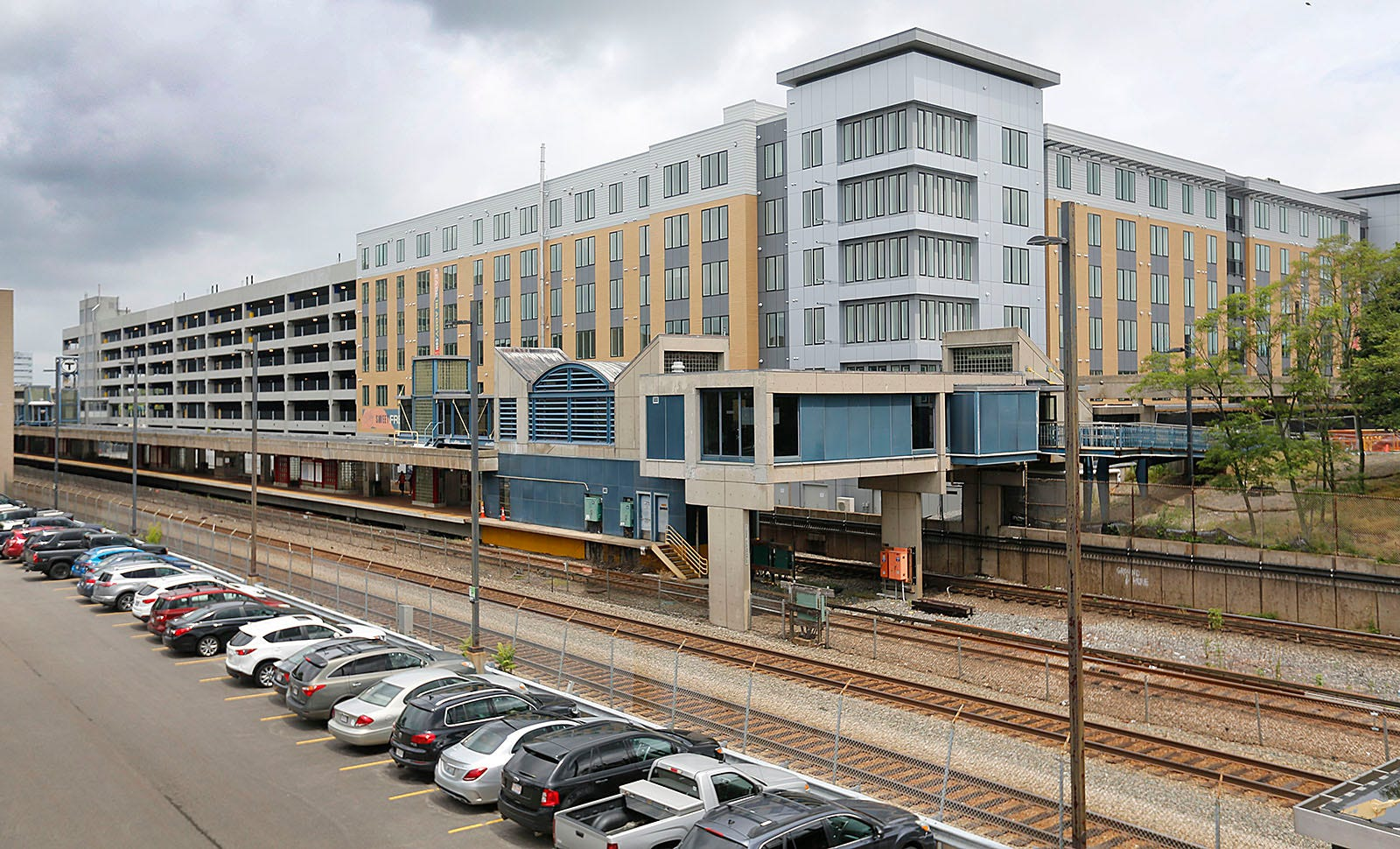 The first phase of a three-building residential apartment complex called The Abby sits over the North Quincy MBTA station. The project will have several retail spaces and be anchored by a Target store.